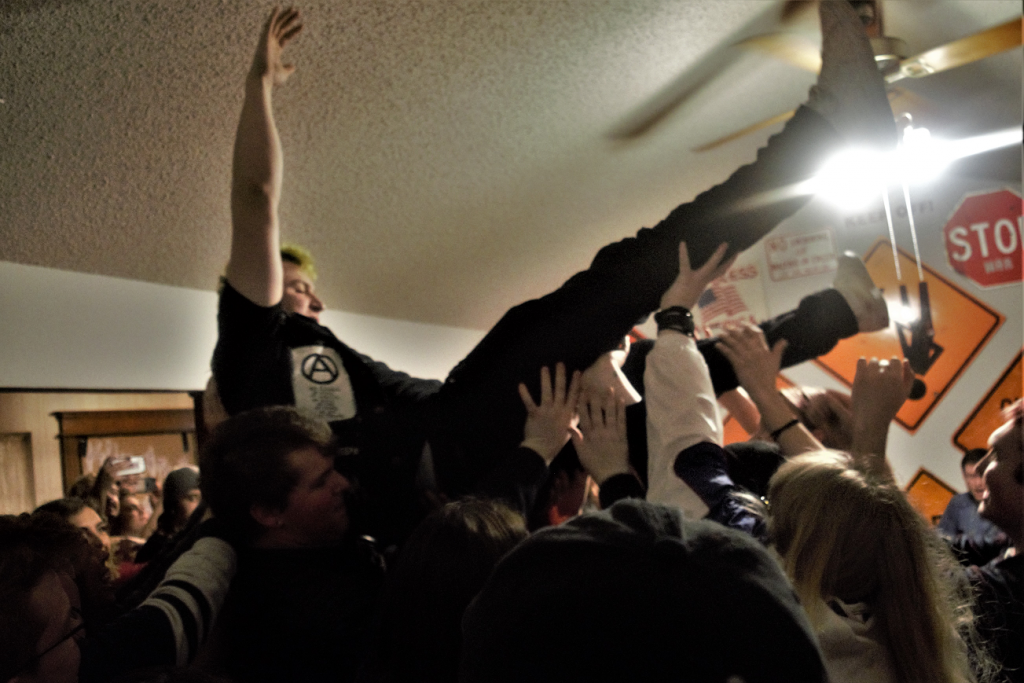 Rob Khaos crowdsurfing at his own venue